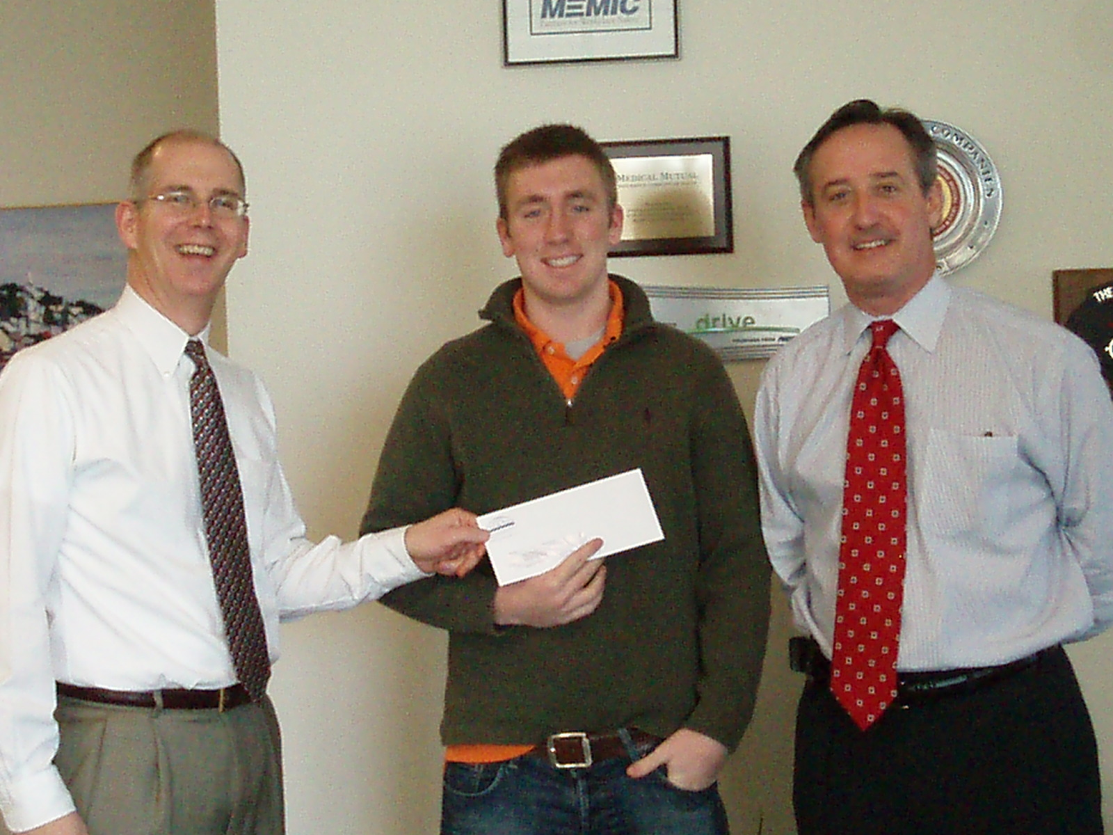 Adam collects his prize from Noyes Hall & Allen Insurance
