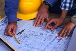 Contractors reviewing plans