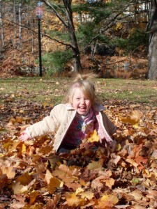 Playing in leaves Penacook NH by Jessica Lang